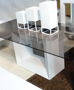 Glass dining table Its precise shape create the illusion of hovering over the floor, the lit up versions convert them into floating architectures.