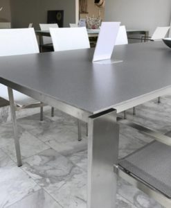 Sleek, slender, elegant and impressive. With beautiful lines and smooth look, This extendable stainless steel table is what dreams are made of. Top is made of etched glass or ceramic.
