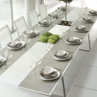 Ego Paris Champagne dining table extrados – plant or champagne bucket extrados.