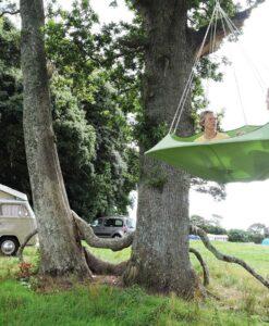 cozy modern hammock swing tree camp glamping green