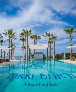 nikki beach pool modern cantilever umbrella marbella ibiza dubai umbrosa st tropez miami