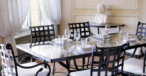 Glass table top is black and white. round or rectangular. The inviting design and bold lines make this a true treasure.