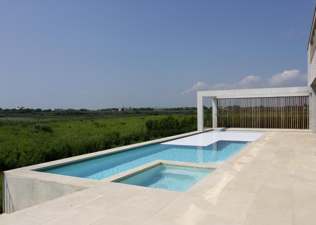 Award winning residential rigid pool cover by covertech - Electric swimming pool covers cost ...
