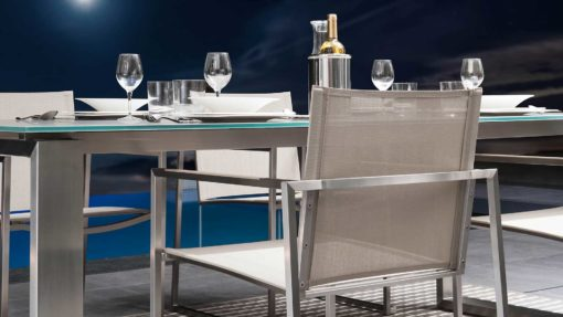 Sleek extendable stainless steel table. With modern flare and style, perfect for romantic dinners or dinner parties.