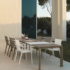 Titus, is a luxury modern outdoor dining table with stone-glass top & stackable dining chairs.This collection is a beauty thanks to its style and unique design.