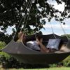 cozy modern hammock swing tree camp glamp taupe hang sky camp 22
