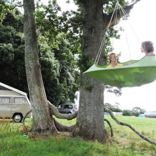 cozy modern hammock swing tree camp glamping green