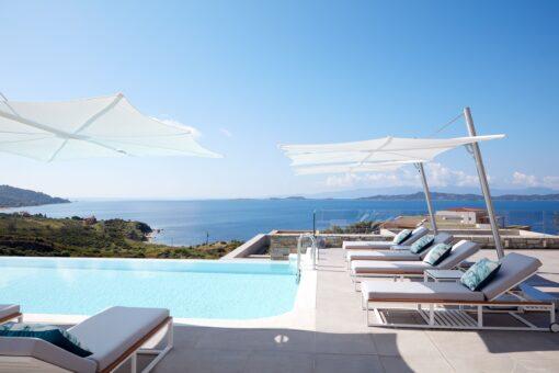 hotel modern umbrella cantilever 360 contract ocean beach club design